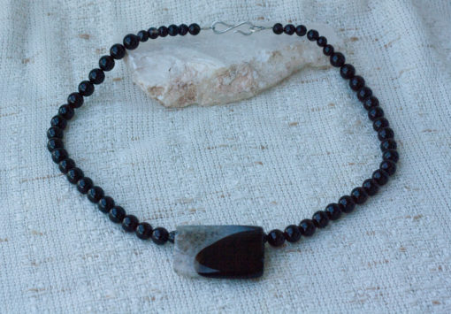 """Basic Black (and White) Necklace has a black agate focal and a black onyx bead """"chain."""" It is finished with a sterling silver clasp. handmade in Texas. 18 Inches Long."""