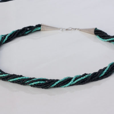 Multi Strand Necklace of Black and Turquoise Colored Matte Seed Beads Finished With a Sterling Silver Hook and Eye Clasp