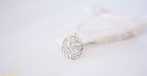 Side View: Hearts and Swirls Necklace Made From Sterling Silver
