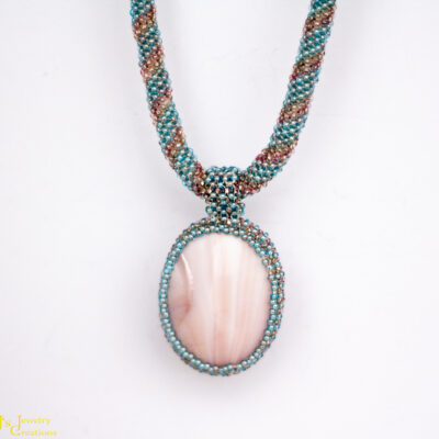 Front View: Pink Mother of Pearl Focal on a Pink and Blue Rope Necklace
