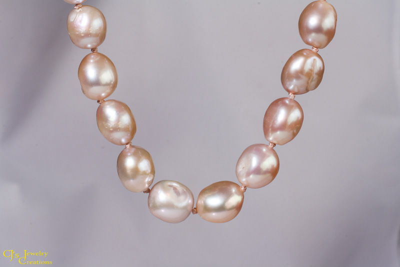 Pink Baroque-style fresh water pearls hand knotted on silk thread and finished with a handmade sterling silver S hook clasp. $48.00