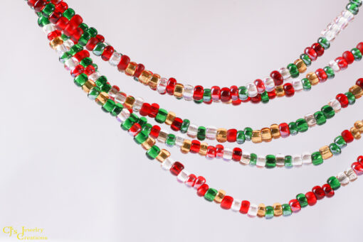 5 Strands of red, gold, green and clear pony beads. Wear it twisted or loose, for 2 different looks.